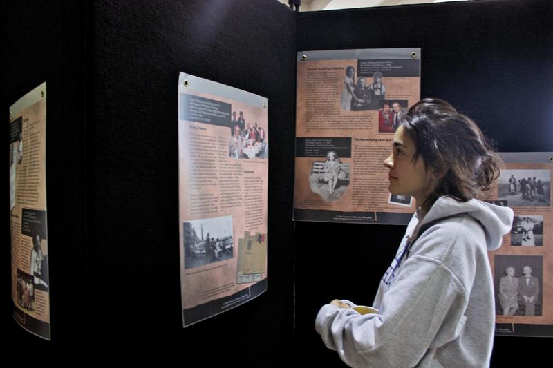Sophomore Audrey Howarth examines the Holocaust exhibit in Karpen Hall. Holocaust survivor Walter Ziffer will speak at UNCA on Wednesday.