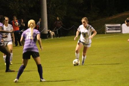Jessica Dooley maneuvers the ball up the field in the game against High Point on Wednesday (Photo by Chris Jones, Sports Staff Writer)