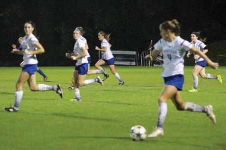 Caroline Houser pushes forward against Presbyterian. (Photo by Chris Jones, sports writer)