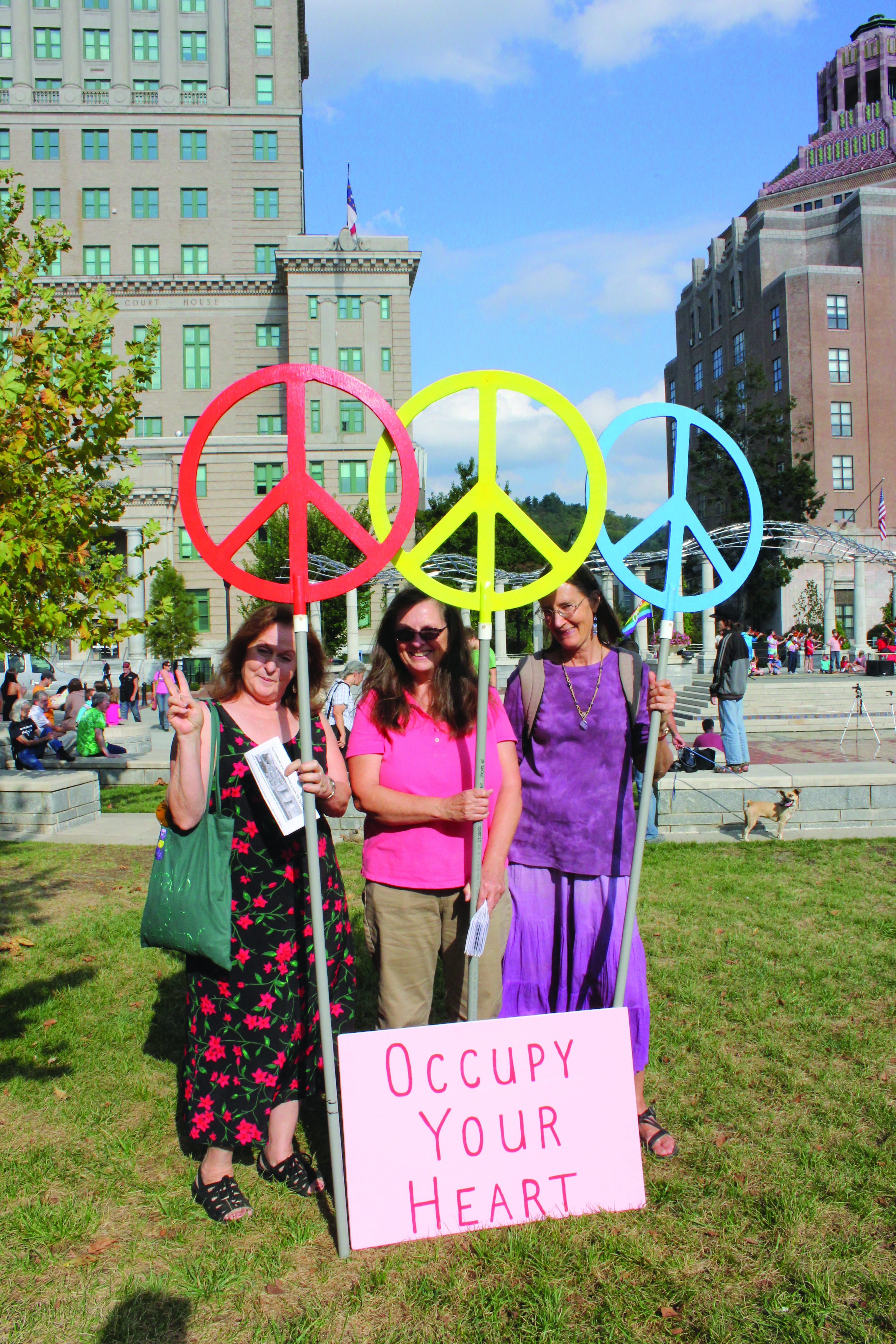 Debralee Williams, left, Laura Sorensen, center, and Cathy Holt, right, protest for peace at the International Peace Day celebration, on Friday, Sept. 21, 2012.