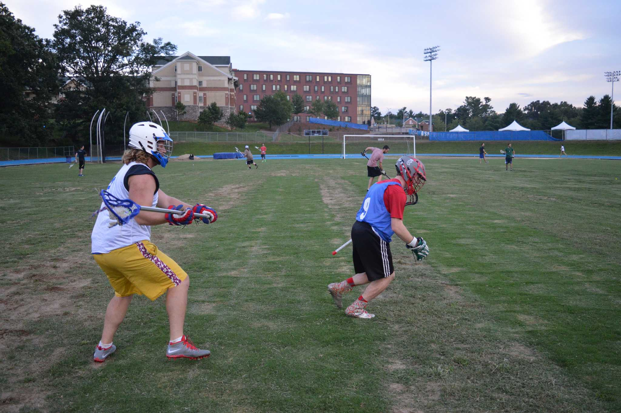 New lacrosse members gather to practice.  Photo by John Armstrong.