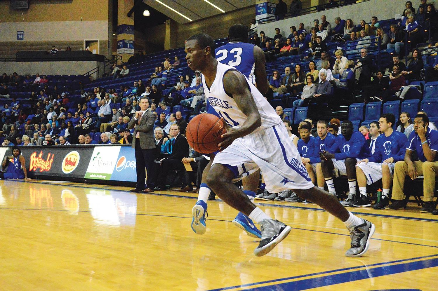 Marcus Neely, a rising sophomore, gains possession of the ball during the exhibition game against Brevard College.  Photo by Max Carter