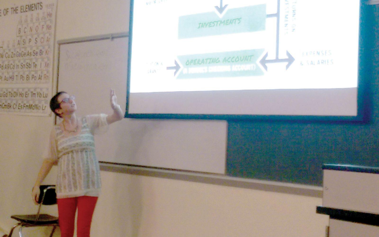 Ashleigh Hillen presents to the audience of the divestment forum last Thursday.  Photo by A.V. Sherk