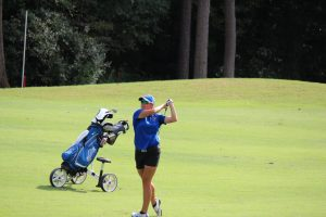 Erica Oldberding follows through on her swing at the Greensboro Invitational. Photo by Charles Heard.